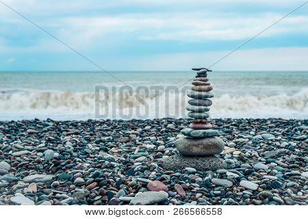 Relaxation At Sea. Stack Of Stones On Beach - Nature Background.