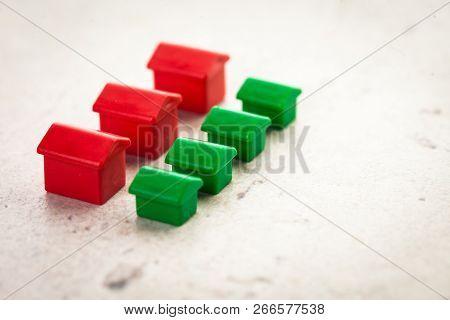 Macro Shot Of Miniature Plastic Houses. Close Up. Pobject. Macro Photography