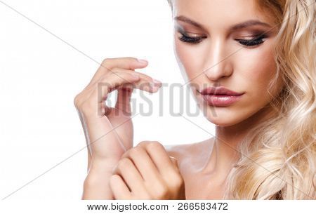 beauty portrait of attractive young caucasian  woman blond isolated on white studio shot  lips  face long hair head and shoulders