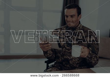 Military Veteran. Disabled Man In A Wheelchair. Man Watching Video On Tablet Pc. Man Is Soldier. Sol