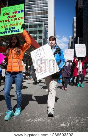 March For Our Lives: A young man marches holding a sign that says Am I Next during the march to end gun violence on 6th Ave, NEW YORK MAR 24 2018.