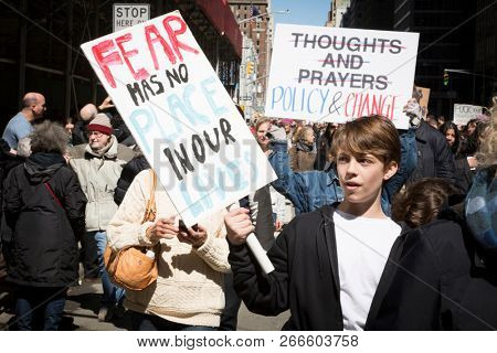March For Our Lives: A young man marches holding a sign that says Fear Has No Place In Our Lives during the march to end gun violence on 6th Ave, NEW YORK MAR 24 2018.