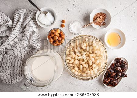 Ingredients For Raw Vegan Cake, Cashew Cake On A White Background, Flat Lay. Plant Based Dit Dessert