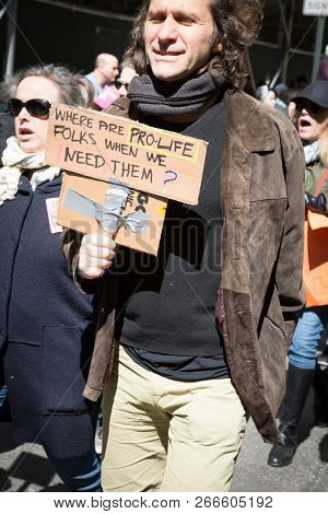 March For Our Lives: A man holds a sign that says Where Are Pro Life Folks When We Need Them during the march to end gun violence on 6th Ave, NEW YORK MAR 24 2018.