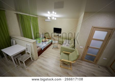 KAZAN, RUSSIA - DEC 7, 2017: Interior of modern lodging divided into kitchen and living zones in hotel Apartments on Bauman. Apartments located near Kazan Kremlin and Kul Sharif Mosque.