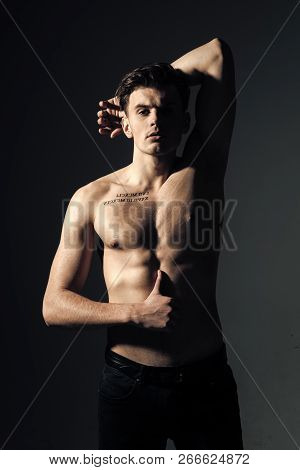 Macho On Pensive Face With Muscular Figure, Sportsman, Bodybuilder. Guy With Tattoo Looks Confident