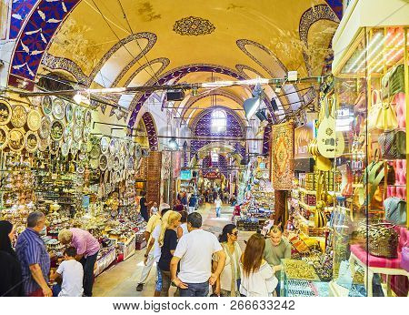 Istanbul, Turkey - July 11, 2018. Tourists At The Passageways Of The Kapali Carsi, The Grand Bazaar