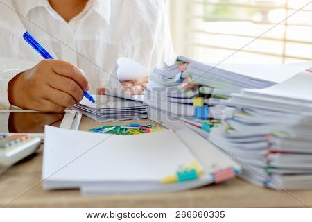 Teacher Is Checking Student Homework Assignment And Report On Desk In School For Score. Unfinished P