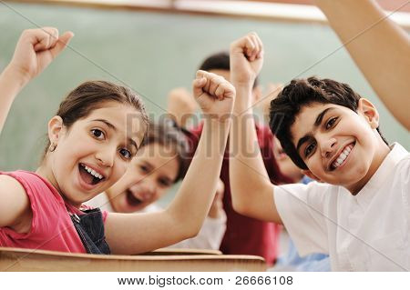 Happy children smiling and laughing in the classroom