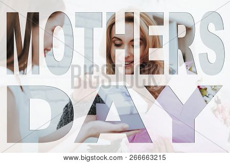 Mothers Day. Happy Family. Daughter Giving Box To Mother. Box With Jewel. Mother Holding Bouquet Of