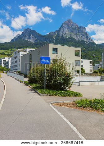 Schwyz, Switzerland - June 23, 2018: View Of The Town Of Schwyz, Mythen Summits In The Background. T