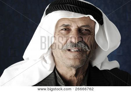 Mature Arabic man with traditional clothes