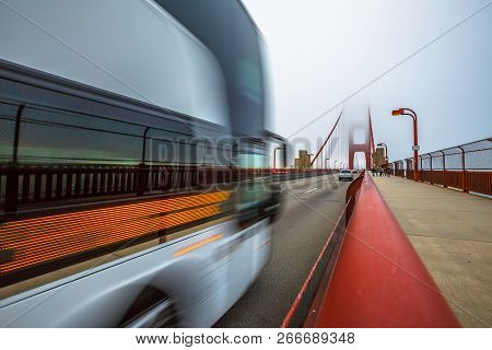 Bus Crossing Golden Gate Bridge From Presidio Pacific Point To The North. Motion Blur Effect. San Fr