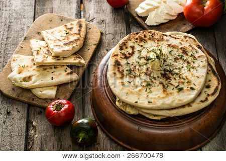 Pita Bread On Wooden Board With Feta Cheese And Tomatoes And Pepper. Still Life Of Food. Georgian Cu