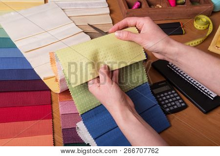 Cabin Curtains. Salesman Showing Fabric Samples For Curtains, Helps With The Selection