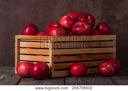 Wooden Box Full Of Apples In Drops Of Water On Dark Boards