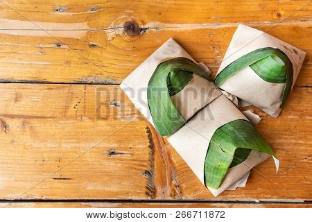 Simple Authentic Nasi Lemak Wrapped In Banana Leaf For Breakfast