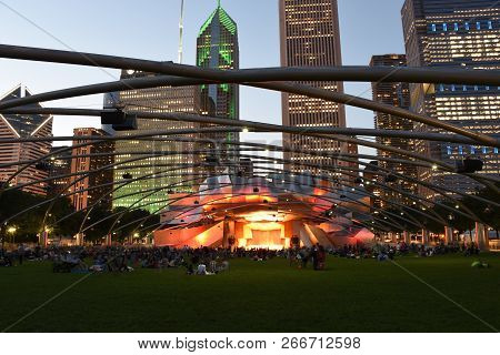 People Gathering On The Grass Lawn At Pritzker Pavilion, Millienium Park After A Concert In The Even
