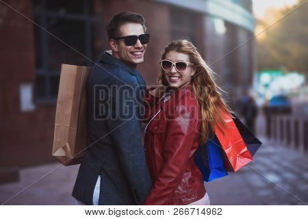Picture Showing Young Couple Shopping In The City. Portrait Of A Couple With Shopping Bags In The Ci