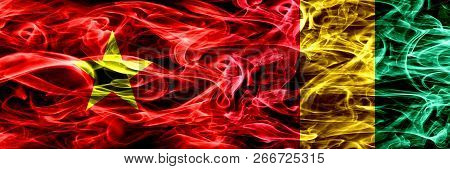 Socialist Republic Of Viet Nam Vs Guinea, Guinean Smoke Flags Placed Side By Side. Thick Colored Sil
