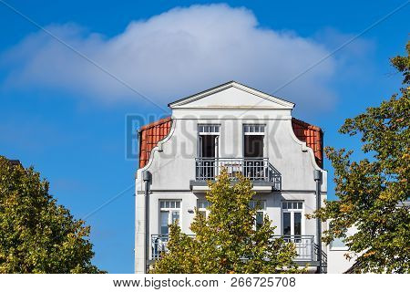 Building With Blue Sky In Warnemuende, Germany.