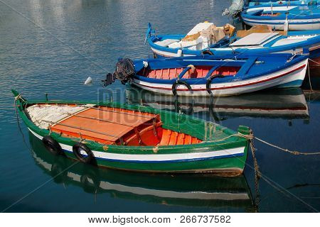 View Of Traditional Sicilian Colorfull Fishing Boat In The Harbour, Syracuse Italy