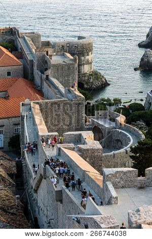Dubrovnik, Croatia, July 29, 2018: Dubrovnik City Walls, The Finest In The World And The City Main C