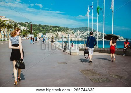 Nice, France - June 26, 2017: Many Tourists Walk Along The English Promenade Of French Riviera At Th