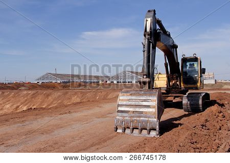 Excavator On The Construction Site. Construction. Excavator. Close Up