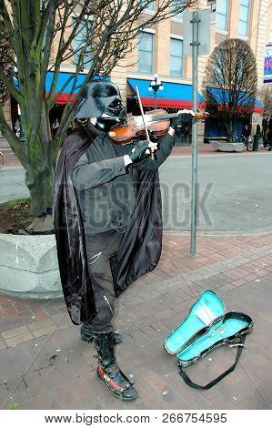 Victoria, Canada. Nov 26, 2004. Circa: Darth Vader, Star War Fictional Character Playing The Violin