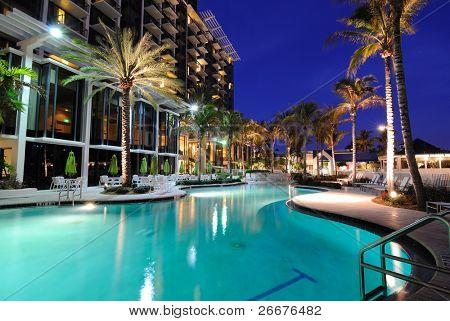 A resort swimming pool at twilight