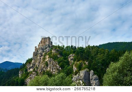 View Of The Castle Ruins Strecno In Slovakia Near Zilina, With Mountains And Forest In The Backgroun
