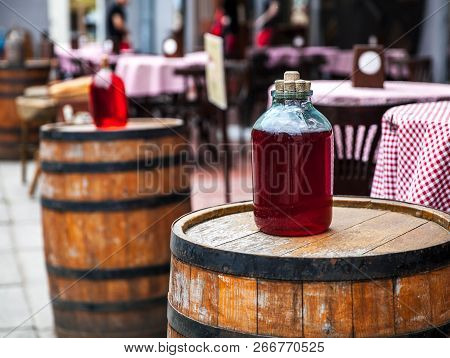 Red Wine Bottle And Wooden Barrel A