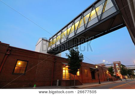 Footbridge over a road in an urban area.
