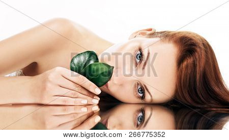 Beautiful young woman with grean leaves. Organic beauty concept. Banner.