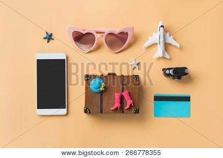 Miniature Travel Accessories And Items With Empty Screen Smart Phone And Copy Space, Travel Concept