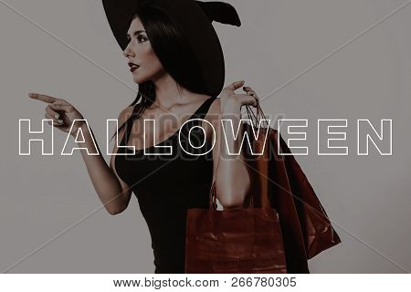 Halloween Makeup. Fashion Sale In Shop Space. Young Woman Stands Sideways. Halloween Sale. Lady In B
