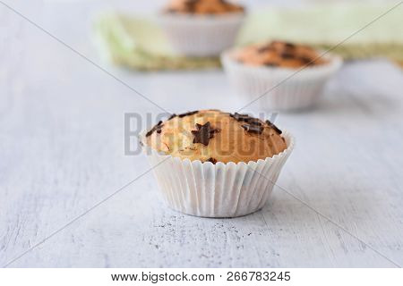 Sweet Delicious Homemade Vanilla Muffins Whit Chocolate Chips At White Wooden Background