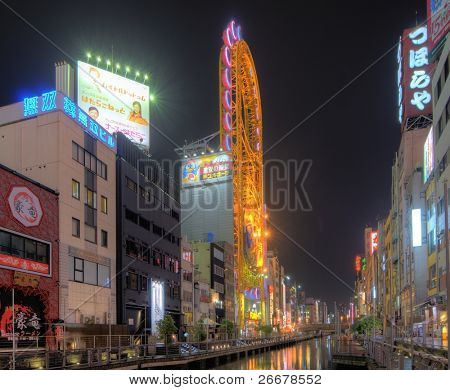 OSAKA, JAPAN - JULY 7: Dotonburi Canal is a manmade waterway dug in the early 1600's and now displays many landmark vivid neon signs July 7, 2011 in Osaka, Japan.