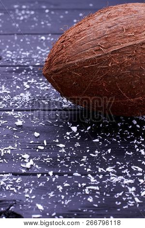 Delicious Tropical Coconut And Copy Space. Healthy Brown Coconut Fruit On Dark Woooden Background, V