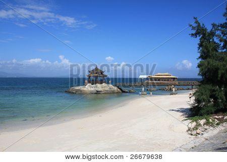 wooden pavilion, azure sky, white sand and blue sea --- Sanya, China