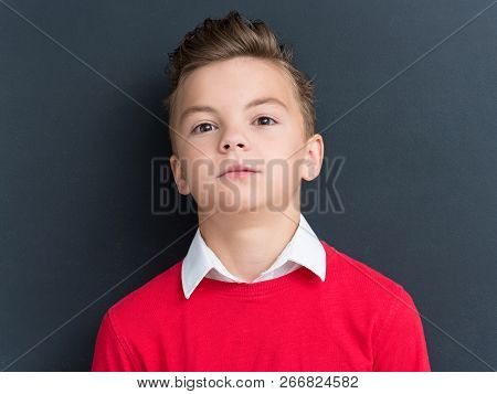 Close-up Emotional Portrait Of Caucasian Teen Boy. Funny Teenager On Black Background.