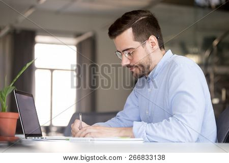 Focused Businessman Making Notes Planning Marketing Research Wor