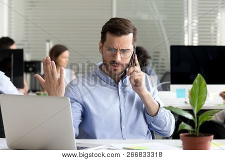 Angry Businessman Caller Talking On Phone Disputing Over Compute