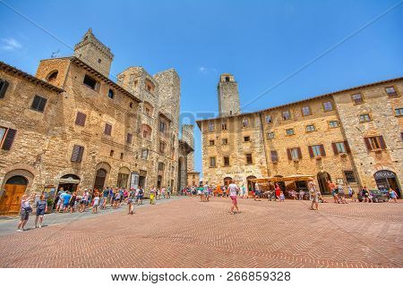 San Gimignano, Italy - July 3, 2018: Panoramic View Of Famous Piazza Della Cisterna In The Historic