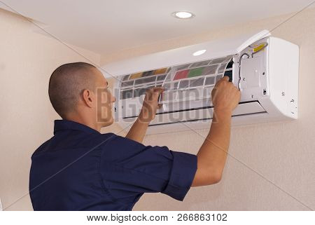 Cleaning And Repairs The Air Conditioner
