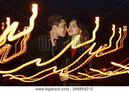 Black Background, Couple Dancing In The Lights Of Light, Dance Of Light, Music Of Light, Holiday.lig