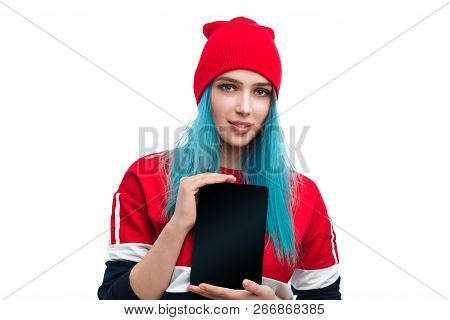 Pretty Informal Woman With Blue Hair Wearing Hat And Showing Modern Tablet Isolated On White Backgro