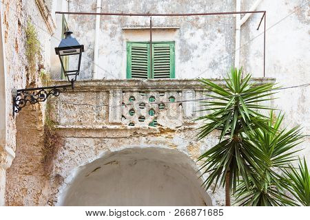 Presicce, Apulia, Italy - Time And Weather Found Their Way To Work At This Balcony