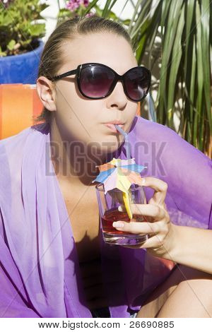 Beautiful Girl With A Long Drink